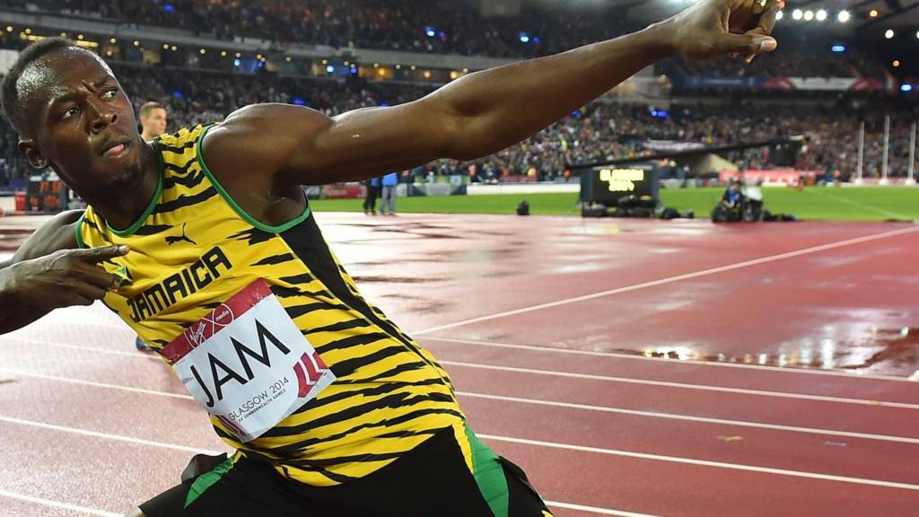 Usain Bolt celebrates Jamaica's relay win