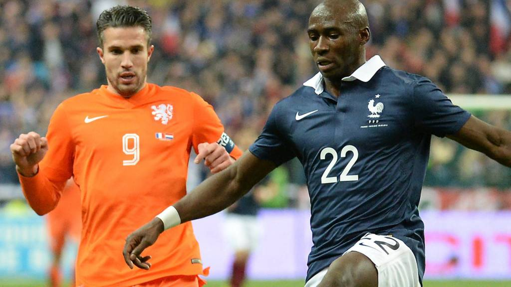 Manchester City signing Eliaquim Mangala fends off Manchester United's Robin van Persie during a match between France and Holland