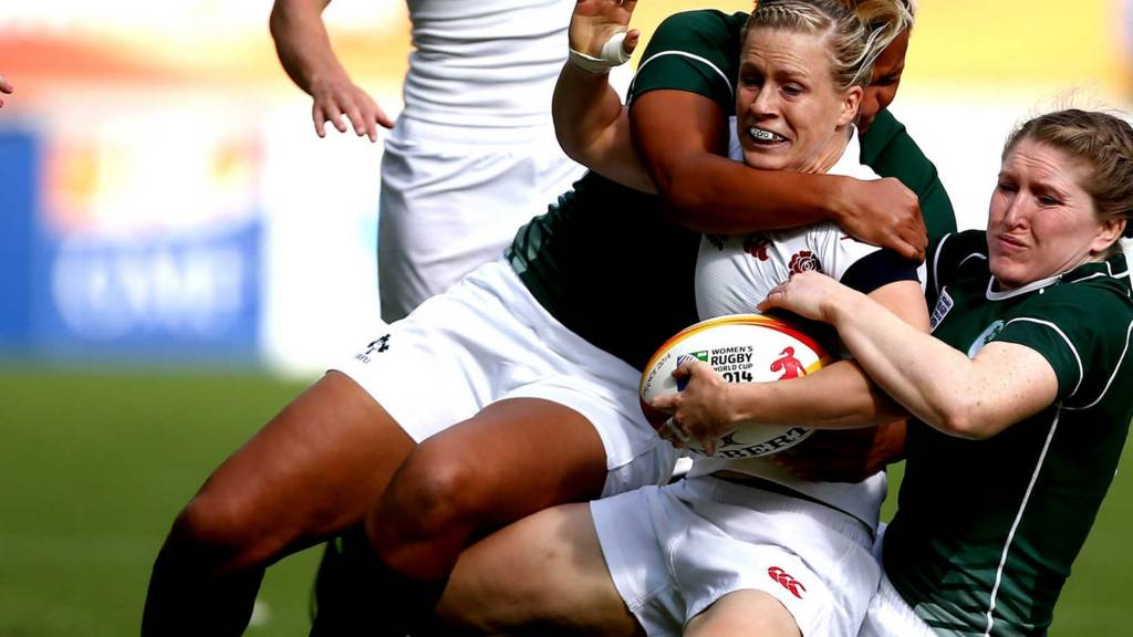 England's Danielle Waterman is tackled in the match against Ireland