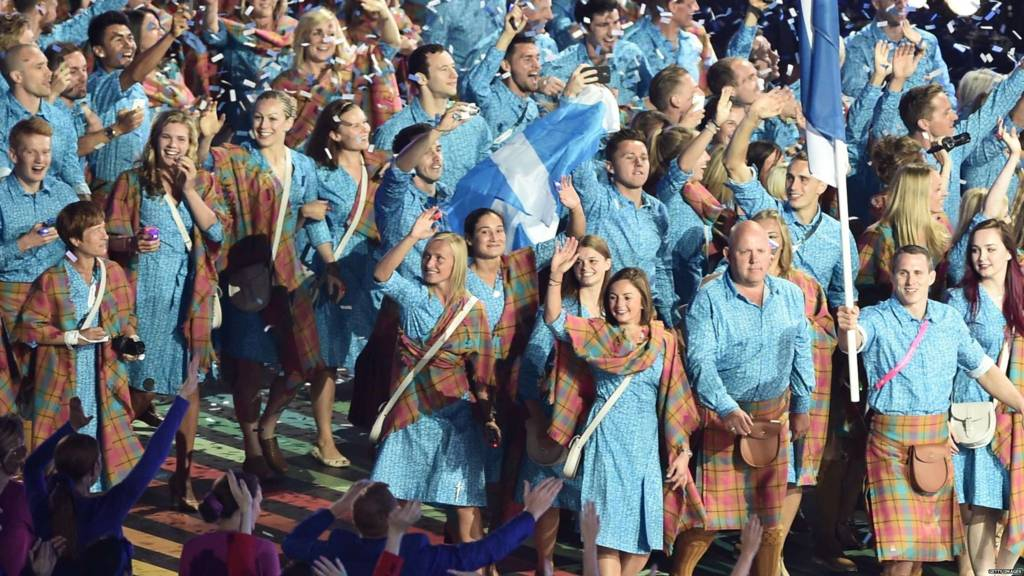 Members of the Scotland deleagtion walk past during the opening ceremony of the 2014 Commonwealth Games at Celtic Park