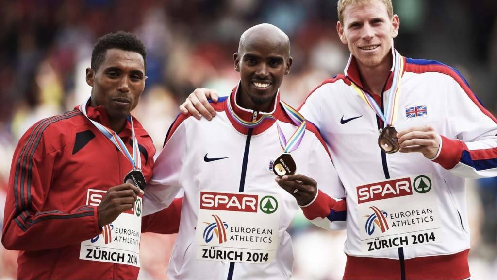 5,000m medallists pose on the podium