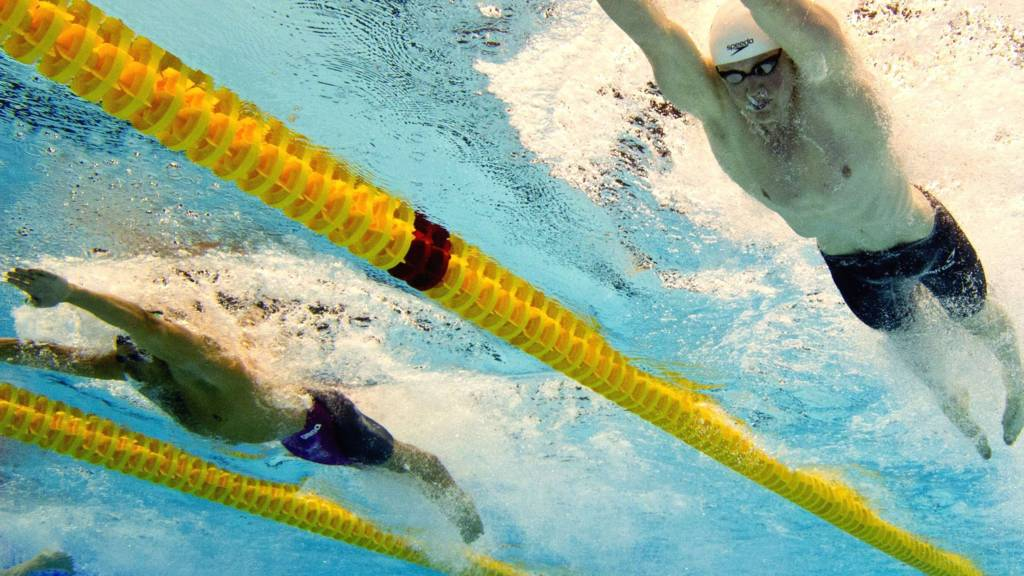 Taken underwater shows Great Britain Adam Peaty and Italy Mattia Pesce competing in the 50m breaststroke