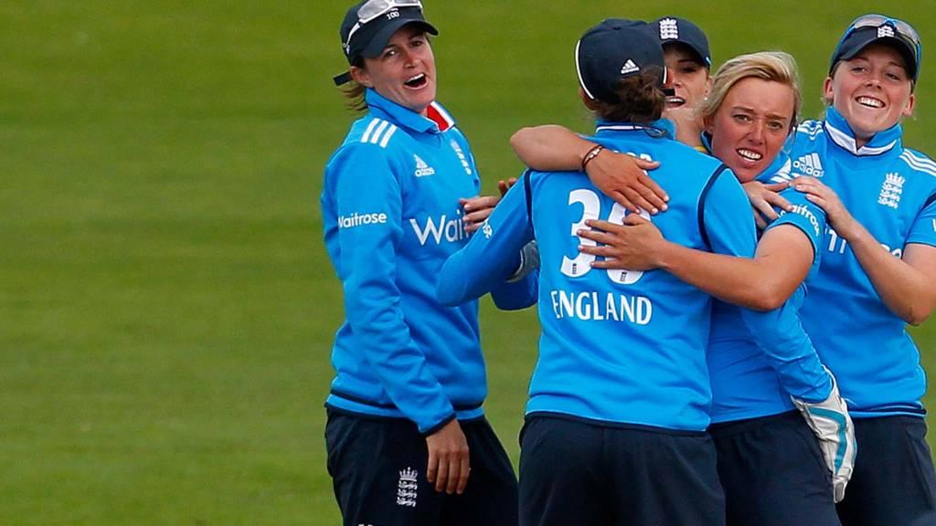 Danielle Hazell of England celebrates with team mates