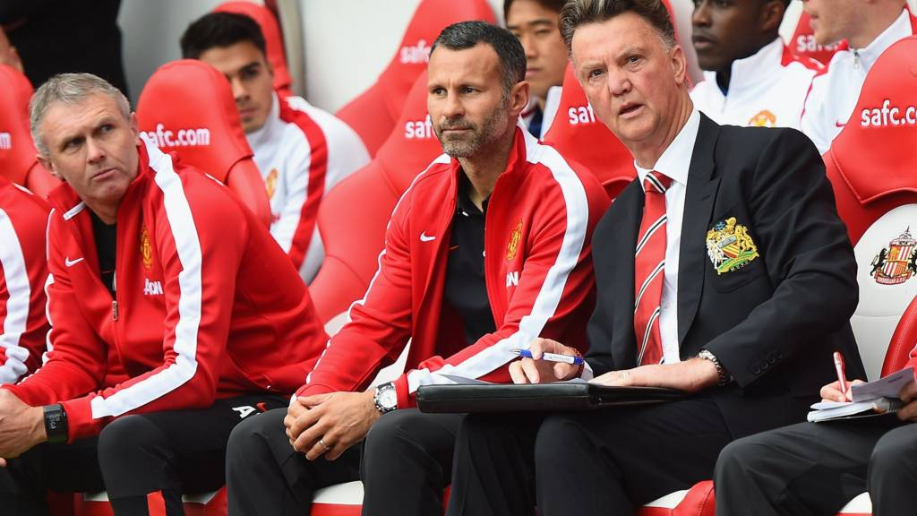 Manager Louis van Gaal and assistant Ryan Giggs of Manchester United sit on the bench