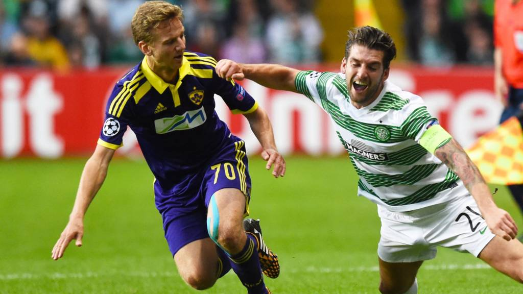 Celtic's Charlie Mulgrew (right) is tackled by Ales Mertelj