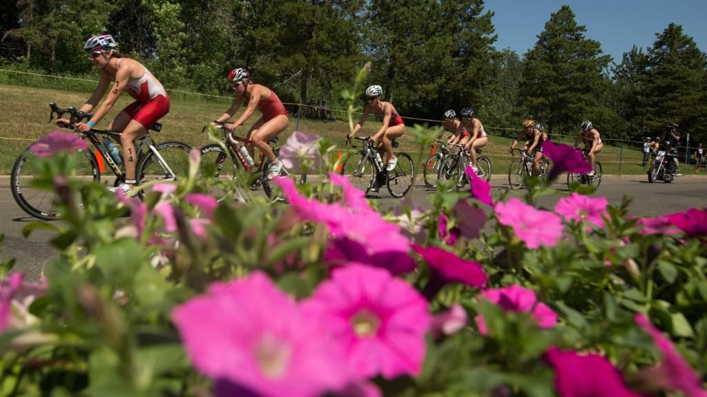 The elite women's field race through William Hawrelak Park at the Edmonton ITU Triathlon World Cup