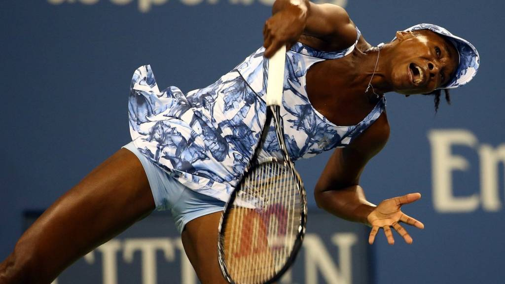 Venus Williams serves at the 2014 US Open