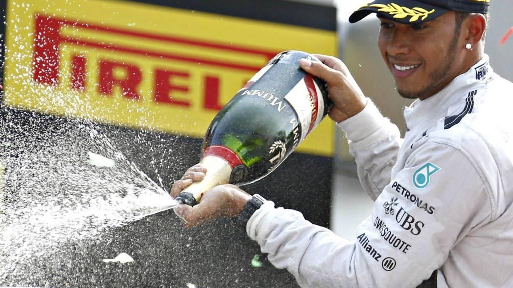 Lewis Hamilton celebrates his win in the Italian Grand-Prix