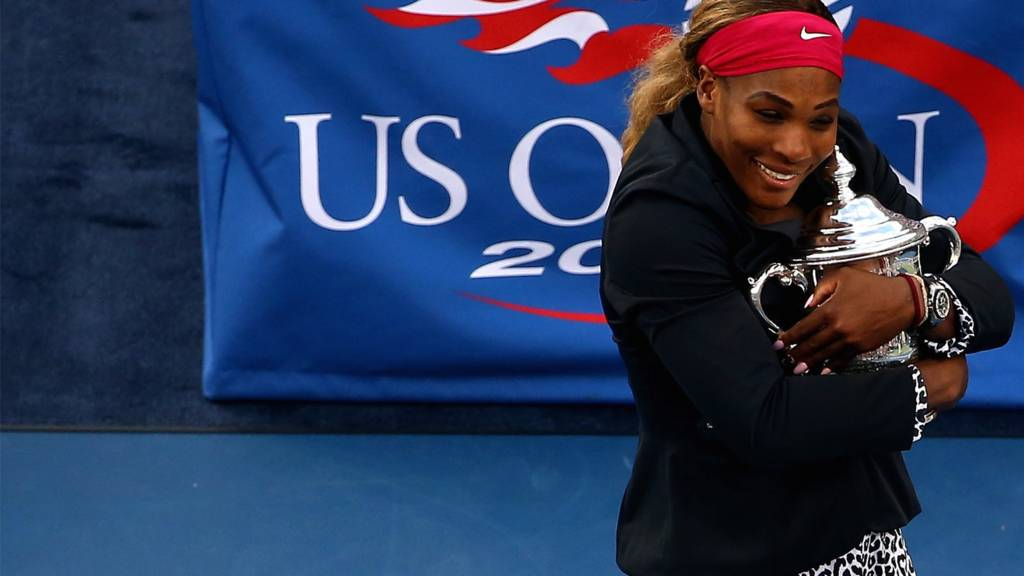 Serena Williams of the United States celebrates with the trophy