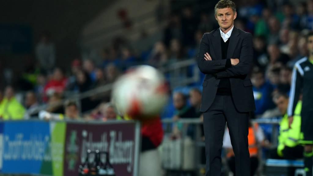 Ole Gunnar Solskjaer watches his Cardiff side