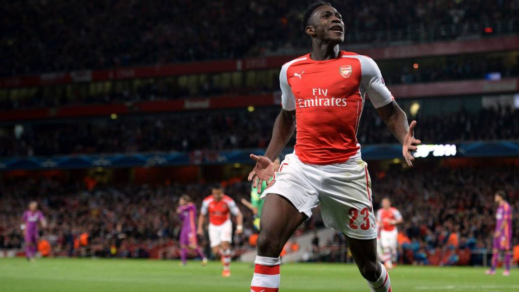 Danny Welbeck celebrates a hat-trick for Arsenal