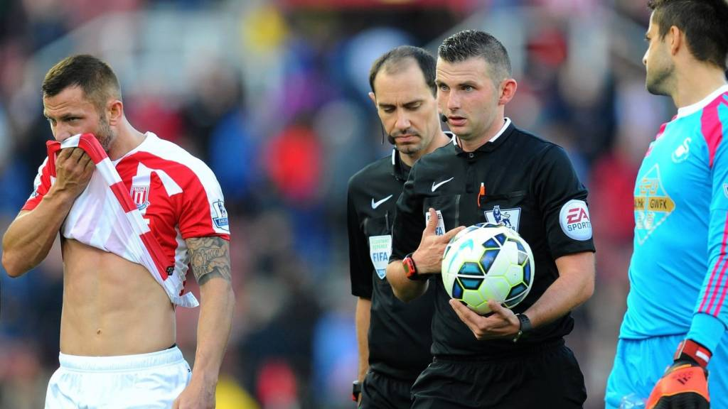 Referee Michael Oliver leaves the field