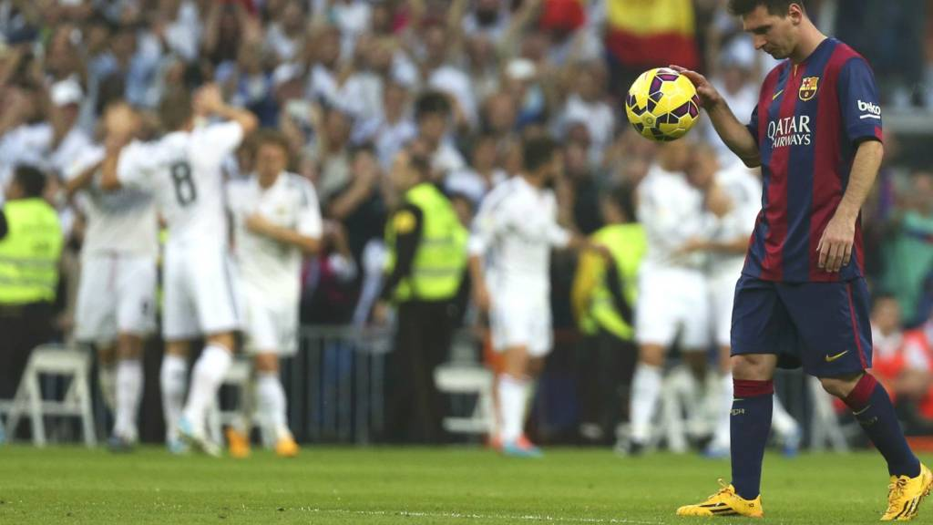 Lionel Messi walks off the pitch as Real Madrid celebrate