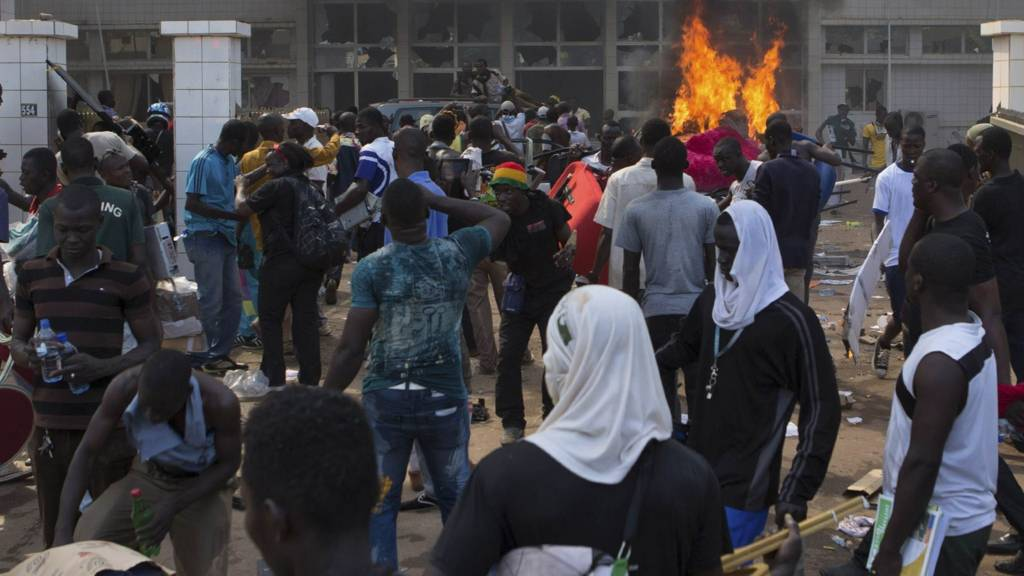 Anti-government protesters set fire to the parliament building in Ouagadougou, capital of Burkina Faso, 30 October 2014
