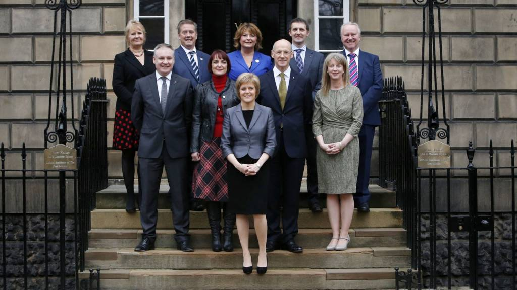 Nicola Sturgeon stands in front of her new cabinet