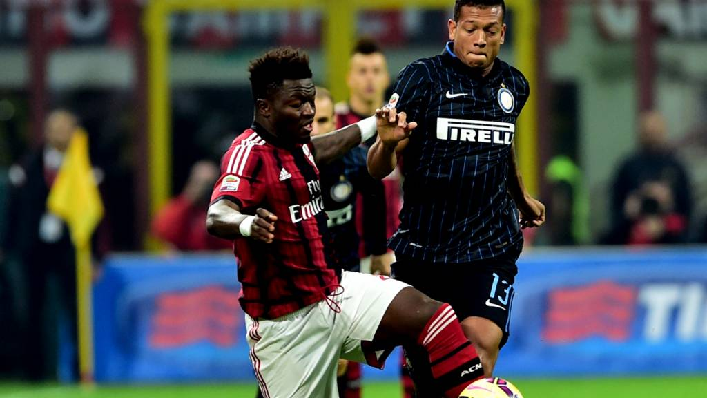AC Milan's Sulley Muntari and Inter's Fredy Guarin