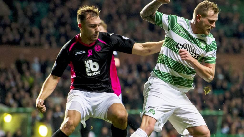 Celtic striker John Guidetti and Partick defender Conrad Balatoni