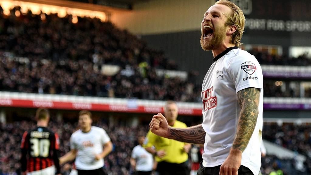 Johnny Russell celebrates