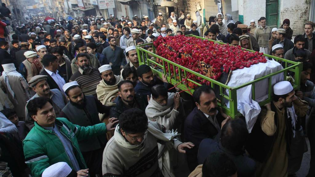 People carry the coffin of a male student who was killed in Tuesday's attack on the Army Public School, during his funeral in Peshawar - 17 December 2014