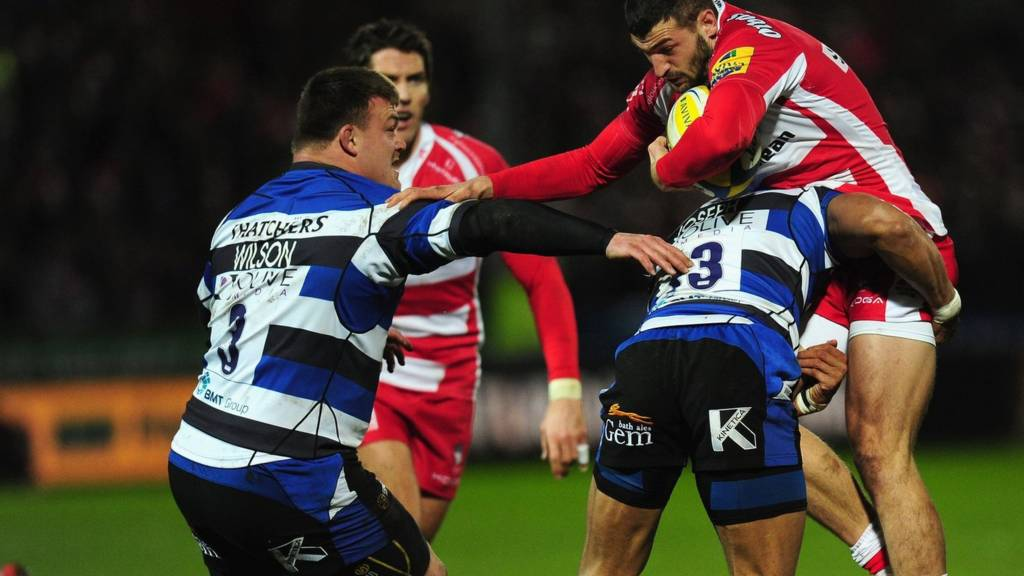 Jonny May is tackled