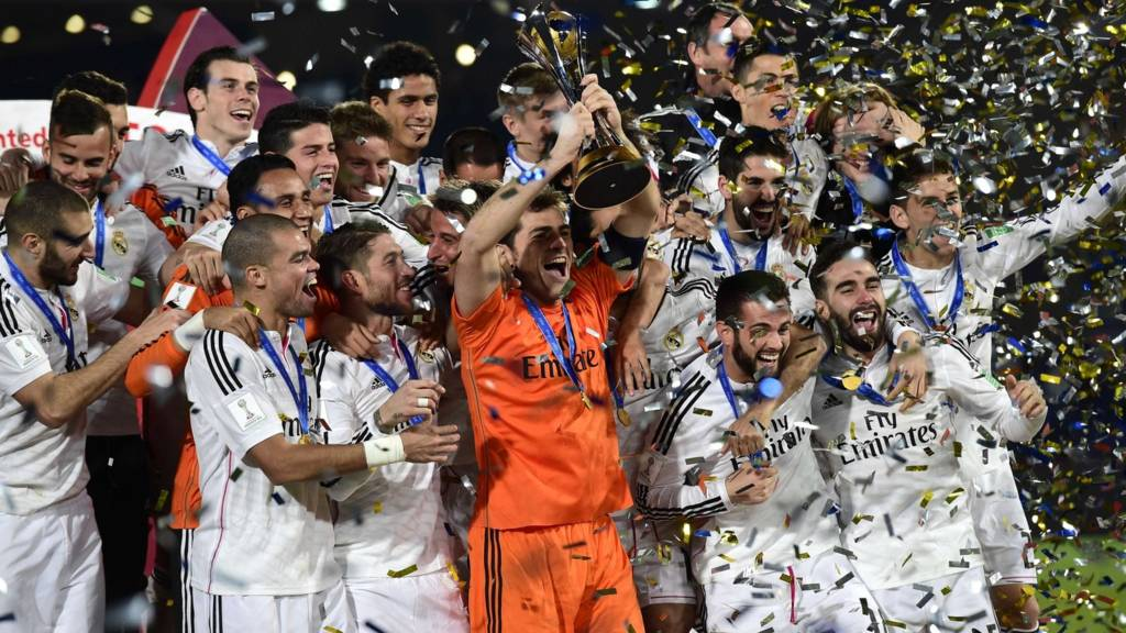 Real Madrid celebrate with the trophy