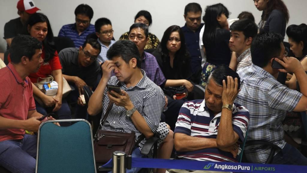 Relatives wait at Juanda International Airport, Surabaya (28 Dec 2014)