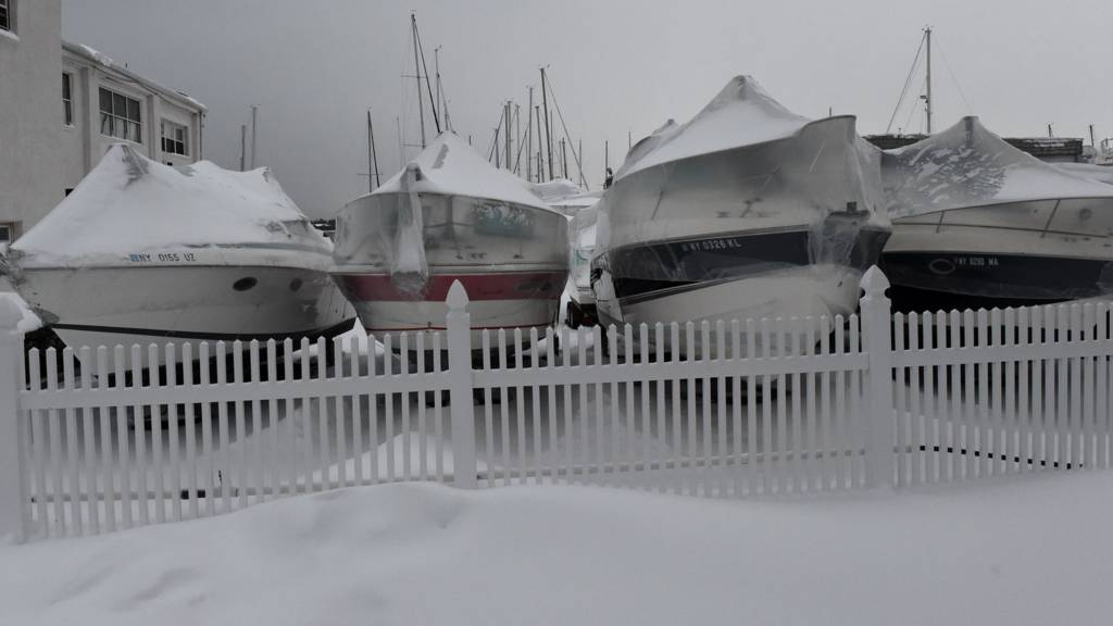 Dry docked boats are covered with snow January 27, 2015 in the Bronx borough of New York City