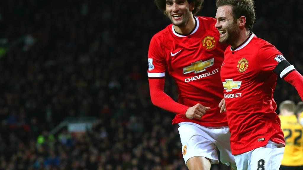 Juan Mata celebrates