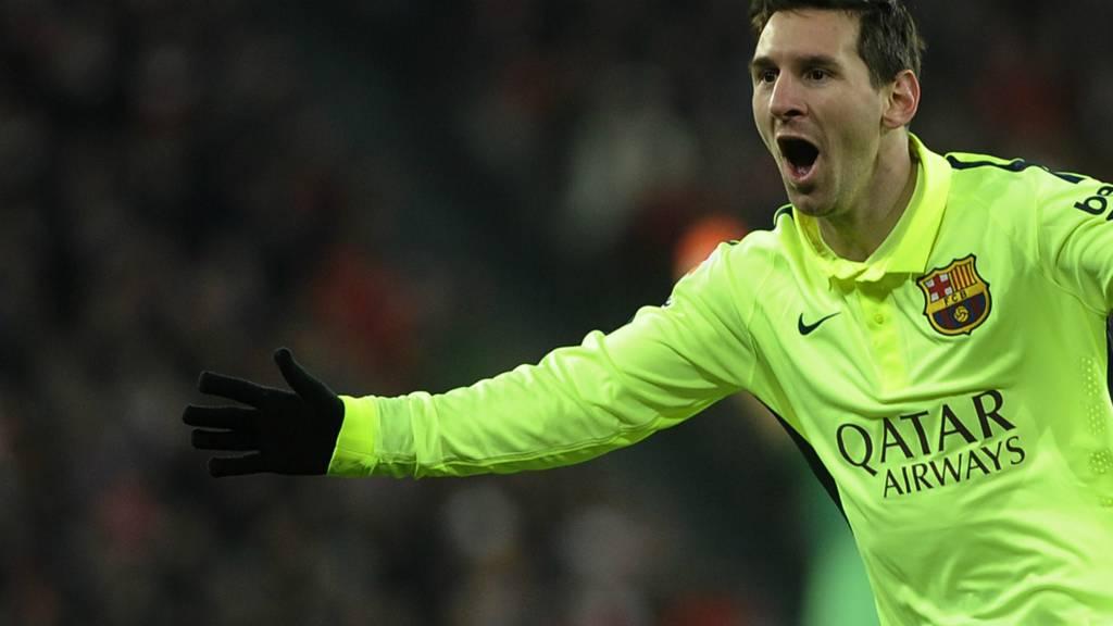 Lionel Messi celebrates for Barcelona