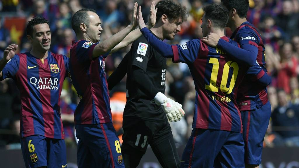 Messi celebrates with Barcelona teammates