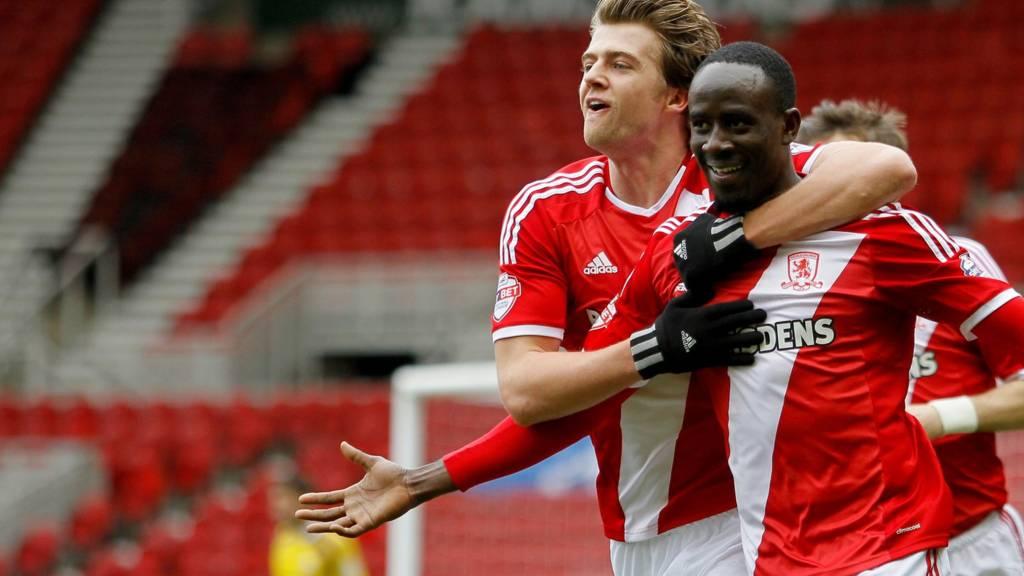 Albert Adomah celebrates with Middlesbrough's Patrick Bamford