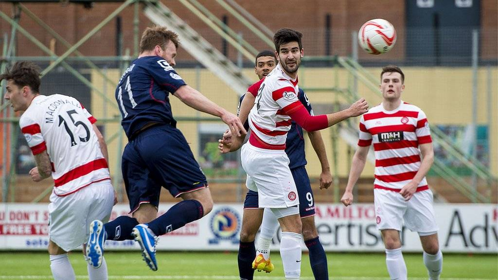Craig Curran heads Ross County's leveller