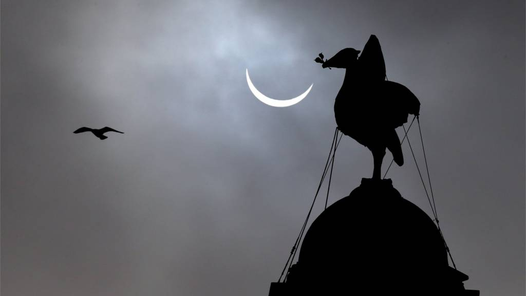 Eclipse with the Royal Liver Building in background