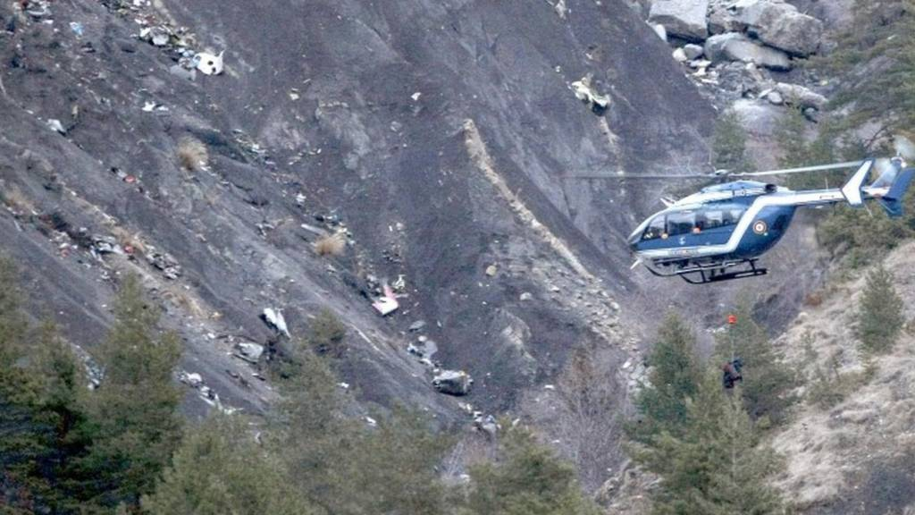 A rescue helicopter over the crash site in the French Alps
