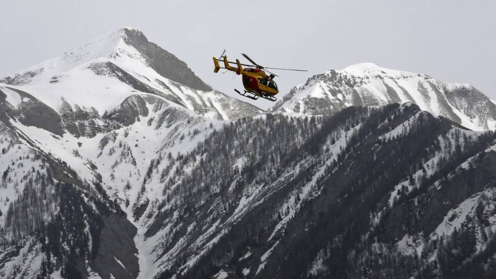 Helicopter flying over the French Alps after the Germanwings airliner crash (24 March 2015)