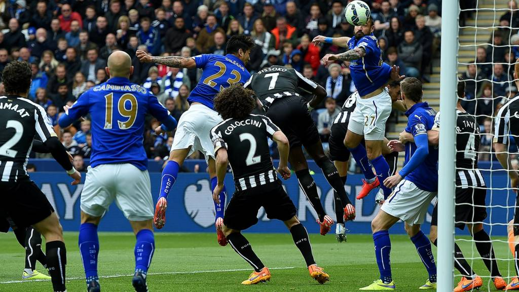 Leonardo Ulloa of Leicester City heads the opening goal against Newcastle United
