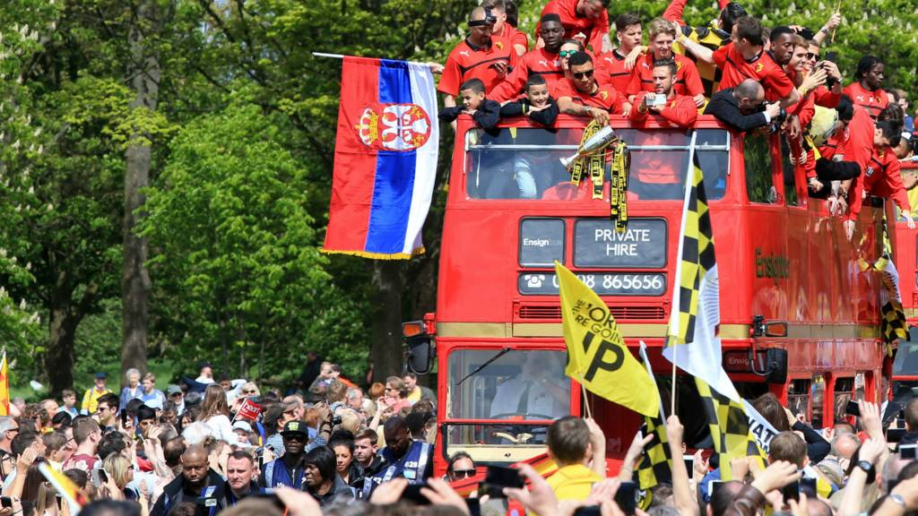 Watford players celebrate on open-top bus