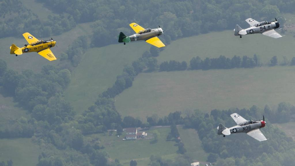 World War II era trainer aircraft practice formation flying over Culpeper Regional Airport in Brandy Station, Virginia, May 7, 2015.