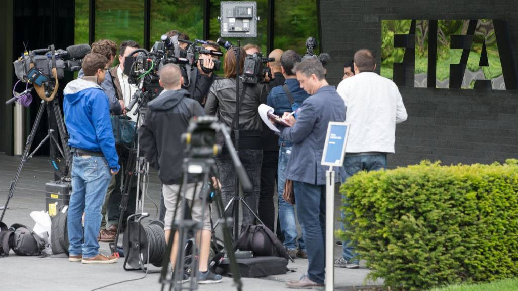 TV stations work after a press conference at the FIFA headquarters on May 27