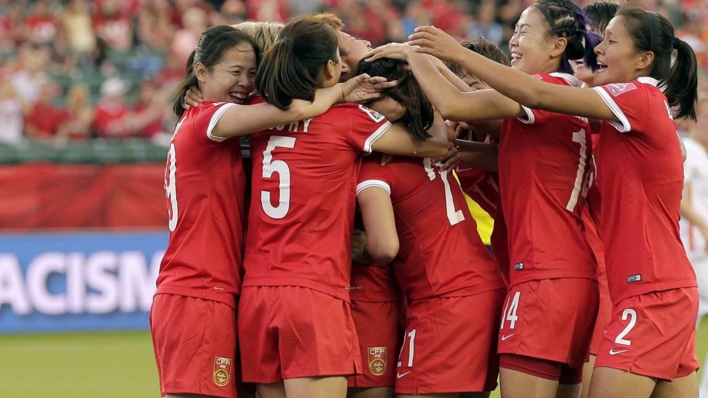 China PR players celebrate
