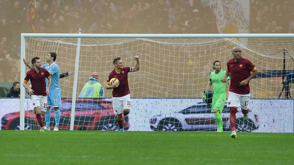 Roma legend Francesco Totti celebrates scoring against rivals Lazio