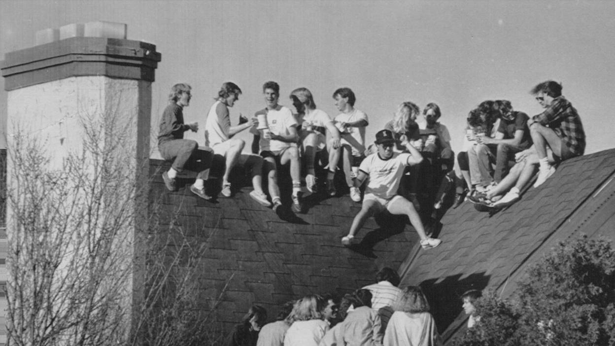 Members of Sigma Ki party up on the roof of their Frat house.