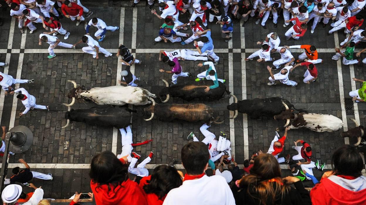 The bulls run through Pamplona