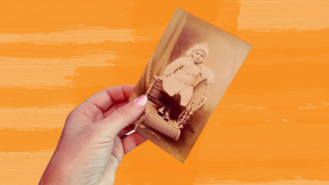 Woman holding old photo