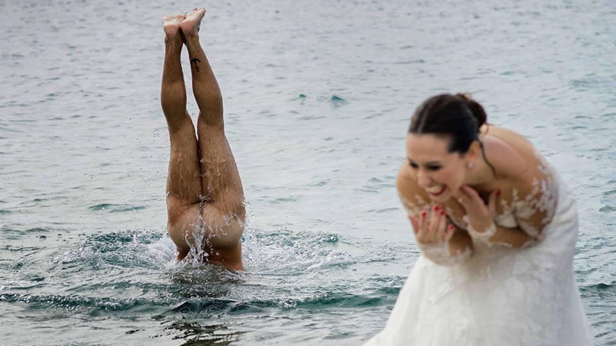 Man skinny dipping as bride laughs