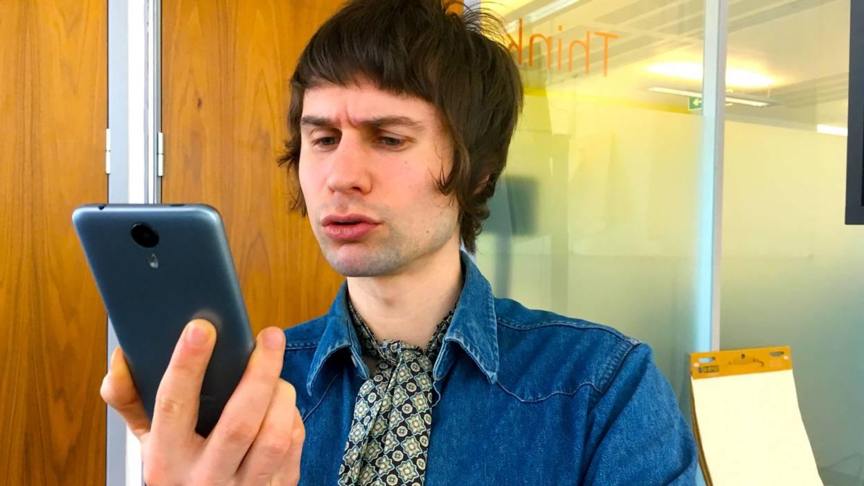Ciaran Varley talks to phone