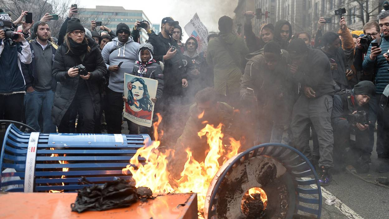 Protesters set fires in protest against the inauguration of President Donald Trump.
