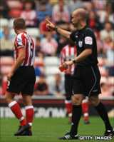 Lee Cattermole is sent off by referee Anthony Taylor on the opening day
