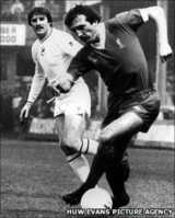 Robbie James (left) playing against Liverpool
