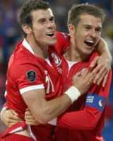 Gareth Bale and Aaron Ramsey celebrate Wales' win over Montenegro